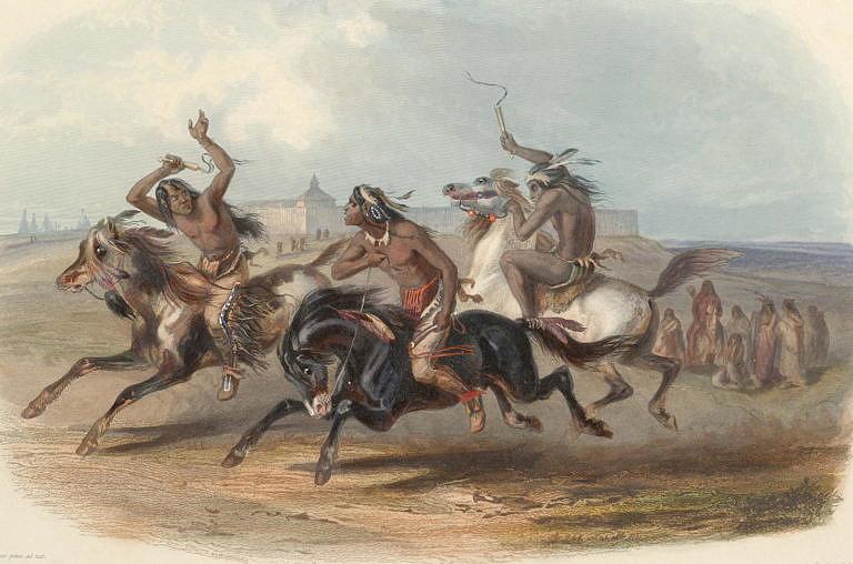 Indiáni kmene Sú (Sioux) soutěží v dostizích. Dostihové koně měli mnohem vyšší hodnotu, než koně běžné. Malba Karl Bodmer.