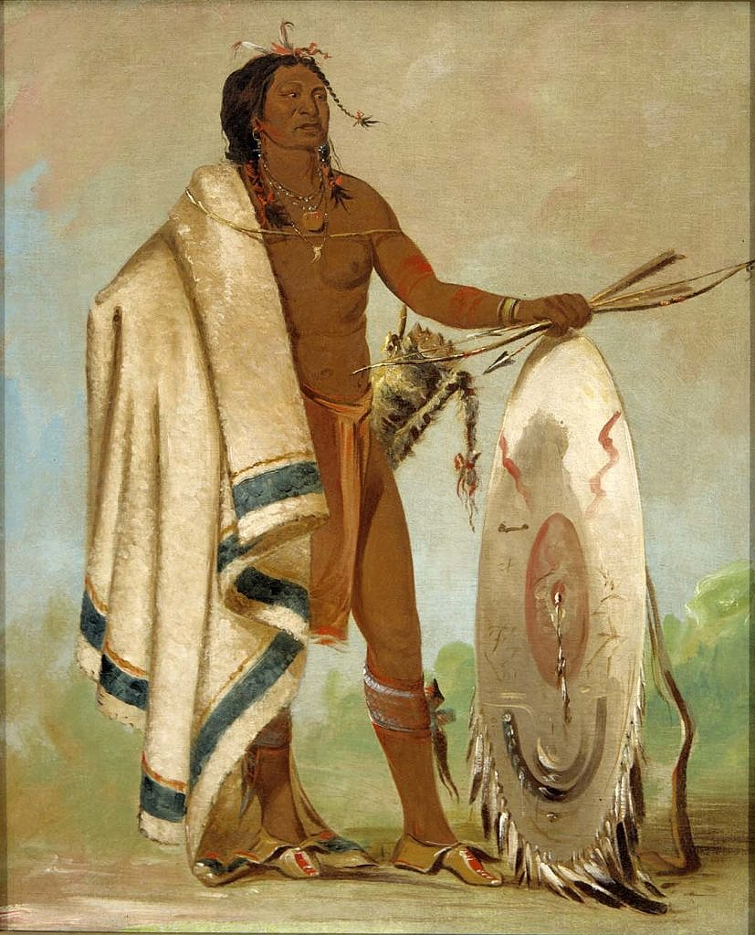 Indiánský válečník na kresbě Georga Catlina. 30. léta 19.století. Přes rameno má přehozenou Hudsons Bay deku, bílou s černýmy pásy.