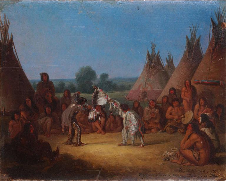 Obřadní tanec kmene Černonožců namaloval v roce 1848 malíř Paul Kane. Tanečníci drží v ruce troubele od posvátných medicinových dýmek.