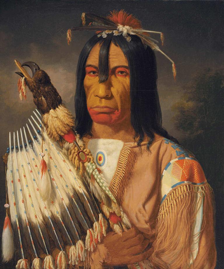 """Náčelník Kríjů """"Ten, který vydává válečný pokřik"""" byl strážcem kmenové medicinové dýmky. Její troubel byla zdobena bohatě orlí hlavou a orlími pery. V roce 1864 jej v jedné z obchodních stanic Hudsons Bay company namalovat Paul Kane."""