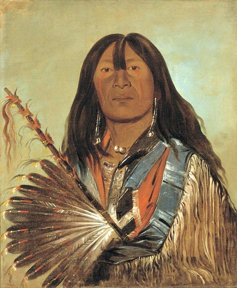 Šonka - Pes, náčelník tlupy Zlých šípových hrotů hunkpapských Lakotů. V ruce má nádhernou dýmku zdobenou orlími pery.