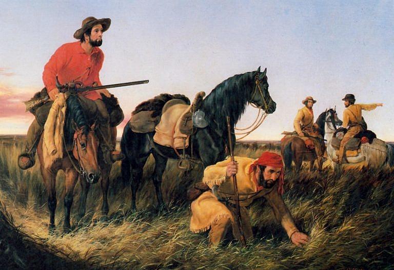 """Obraz """"Trappeři hledající cestu"""" od Arthura Taita. Trapper sedící na koni má na sobě košili z červené bavlny. Látkové košile byly běžnou součástí oblečení západních trapperů (horalů). V chladnějším počasí jich na sobě mohli mít navrstveno i několik."""
