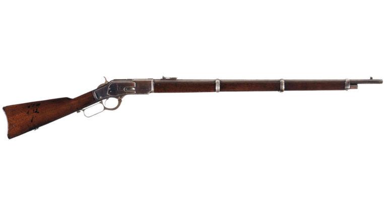 Winchester 1873 ve variantě mušketa s 27 palcovou kulatou hlavní.